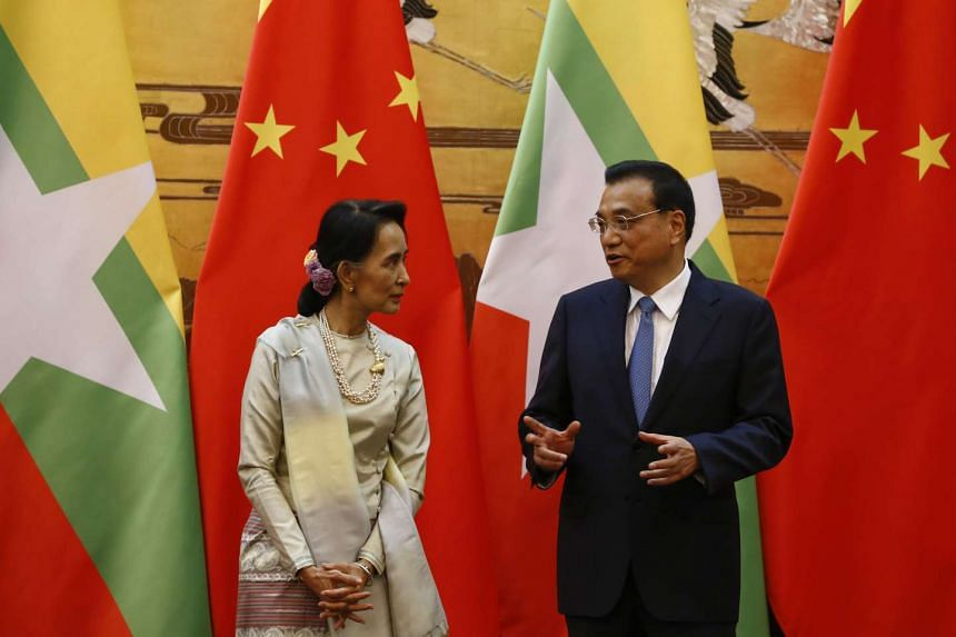 Myanmar State Counsellor Aung San Suu Kyi (left) and Chinese Premier Li Keqiang talk during a signing of agreements ceremony at the Great Hall of the People in Beijing on Aug 18, 2016.