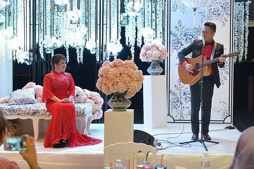 Sezairi performing a ballad he wrote in Malay for his wife which had the entire ballroom mesmerised last night. The couple's marriage solemnisation in January was an intimate affair.