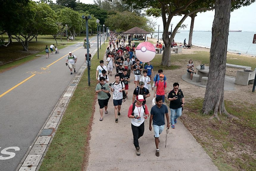 """The mass walk yesterday started from East Coast Park and continued for about 8km to Gardens by the Bay and Marina Barrage. The route passed 53 PokeStops and eight """"gyms"""", the organiser said."""