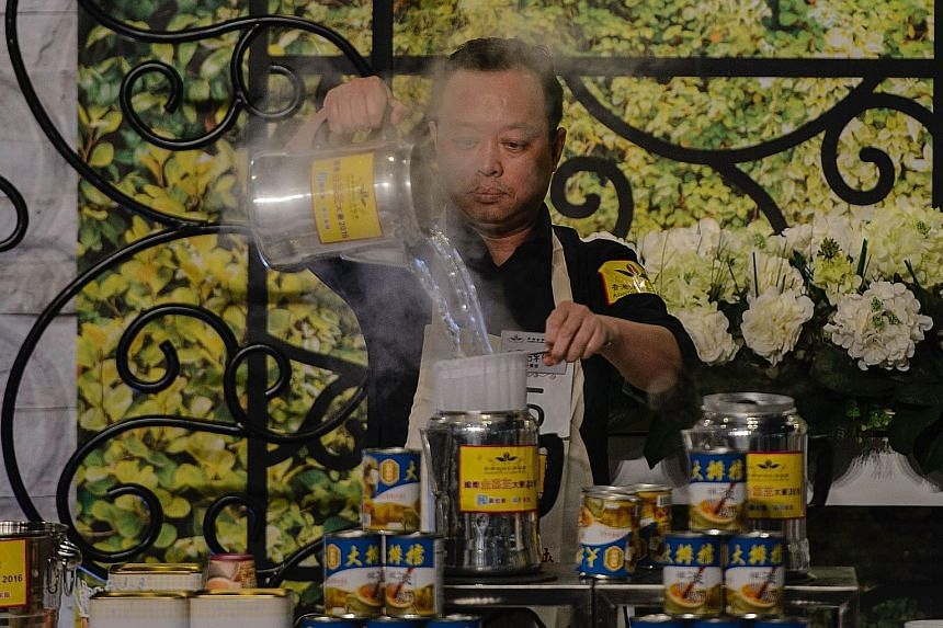 "Hong Kong tea-making champion Chen Chi Ping competing in the International KamCha Competition on Aug 13. Milk tea, or ""lai cha"", is made by straining tea then mixing it with condensed or evaporated milk."