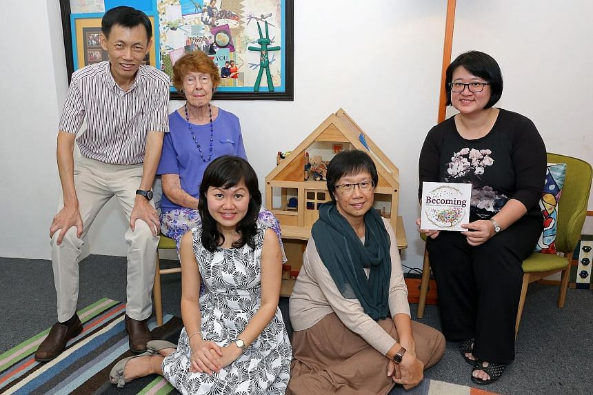 From left: Mr Steven Soh, 47; Mrs Dorothy Lau, 83; Ms Valerie Oh, 36; Mrs Juliana Toh, 56; and Ms Grace Lim, 41, form the team which brought out a new book, Becoming, as part of the Counselling and Care Centre's 50th anniversary.