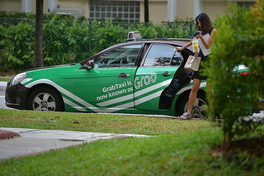 Uber and Grab are going to be disrupted as the next round may see a taxi service using driverless cars, said PM Lee. Singapore will be starting a trial of driverless taxis in one-north next year.