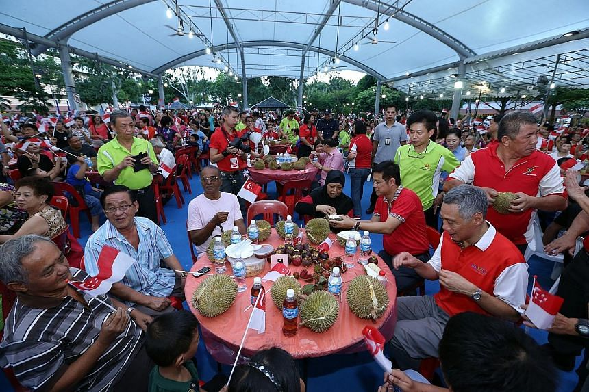 Mr Lee joining residents at the Punggol South Fruits Fiesta. Various races and religions have different food requirements but when it comes to fruits, all barriers come down, he said.