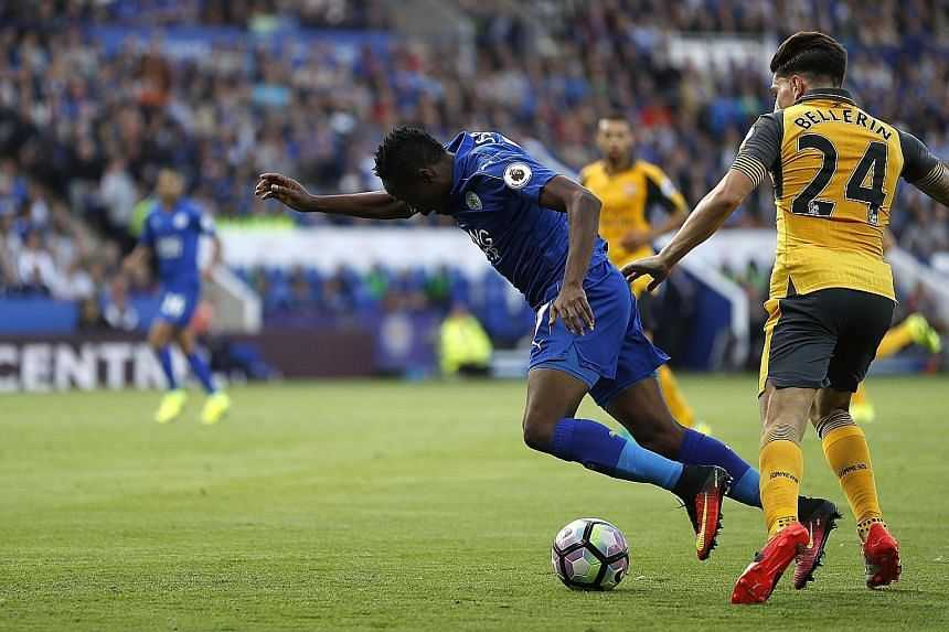 Leicester City's Ahmed Musa going down in the penalty area after a challenge by Arsenal's Hector Bellerin. Referee Mark Clattenburg ignored calls for a penalty, however, as last season's top two sides played out a goal-less draw.