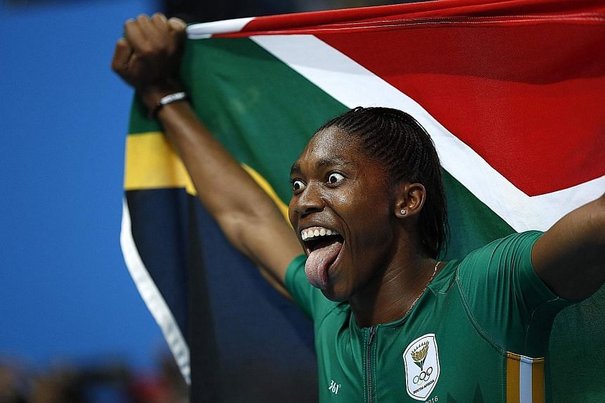 South Africa's Caster Semenya celebrates winning the 800m final. The second-placed Burundian and third-placed Kenyan also have naturally high testosterone levels.