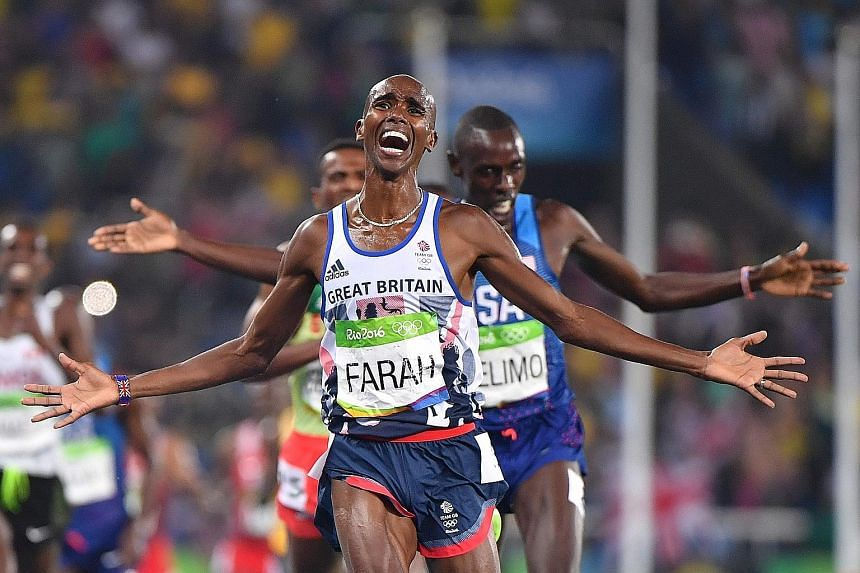 Britain's Mo Farah celebrating as he crossed the finish line to retain the 5,000m gold he won in London four years ago.