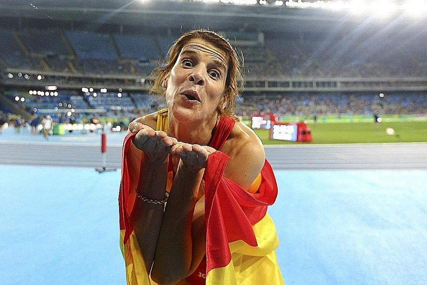Ruth Beitia of Spain celebrating her high jump victory on countback, after four women cleared 1.97m on Saturday.
