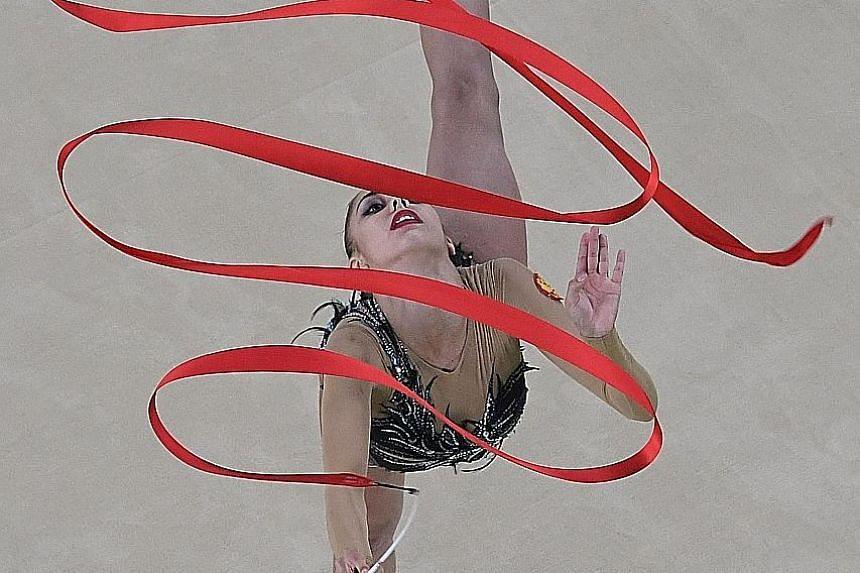 Margarita Mamun continued Russia's hold on the rhythmic gymnastics event by winning the individual all-around gold on Saturday. The 20-year-old beat her world champion team-mate Yana Kudryavtseva, with the Ukrainian Ganna Rizatdinova claiming the bro