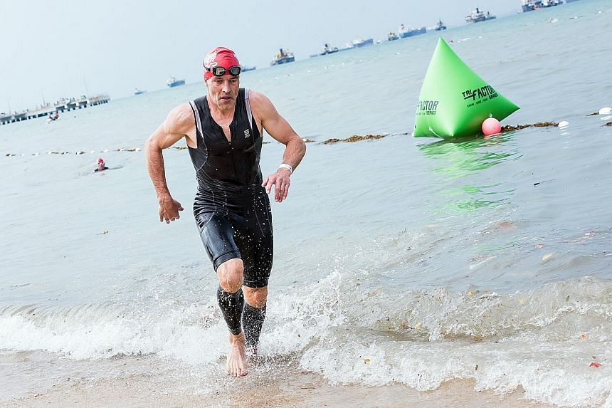 Overall TRI-Factor Series champion Jesper Silkeborg coming ashore after the 750m swim. The Scoot airline captain cites discipline and careful time management and planning as the reasons for his success.