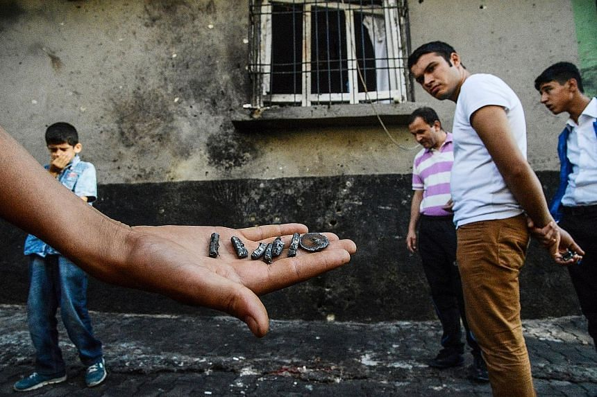Pieces of a projectile found near the explosion scene in Gaziantep. The bride and groom survived the attack but the groom was wounded. Witnesses said there were women and children among the dead.