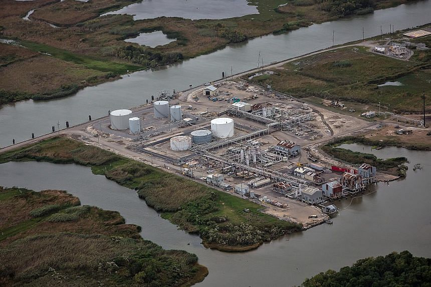 An oil and gas facility in southern Louisiana. Each year, the state loses more than 50 sq km of land to coastal erosion. At Port Fourchon, which services 90 per cent of deepwater oil production, the shoreline recedes by about a metre every month.