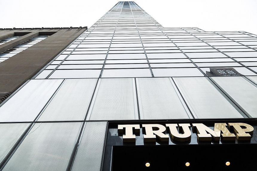 Trump branded merchandise (above) in the lobby of Trump Tower (below) in Fifth Avenue in Manhattan. Mr Trump at the Old Post Office building in Washington, now being developed into a Trump International Hotel under a 60-year lease for which the gover