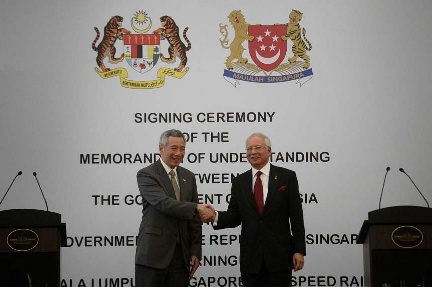 PM Lee Hsien Loong and his Malaysian counterpart Najib Razak shaking hands during the signing of the Memorandum of Understanding for the Singapore-KL high-speed rail, on July 19, 2016.