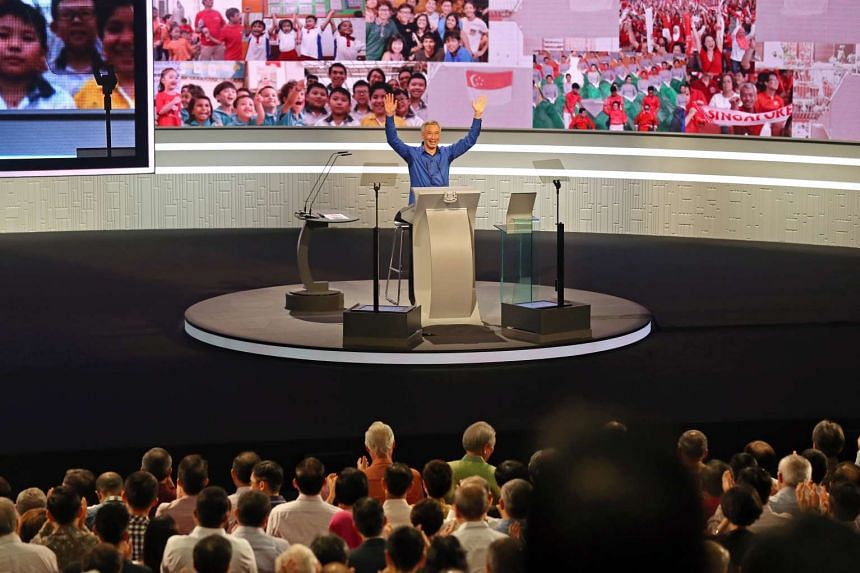 PM Lee Hsien Loong acknowledging the standing ovation given to him by the crowd after he returned, during the National Day Rally at ITE College Central on Aug 21, 2016.