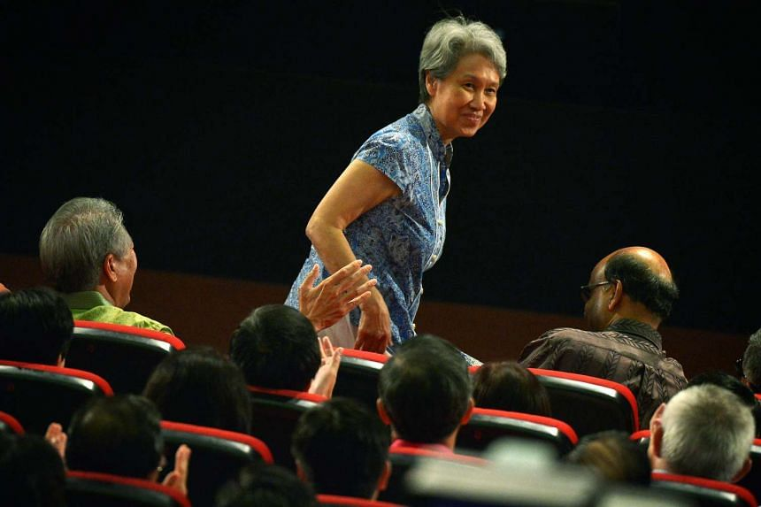 Mrs Lee Hsien Loong returns to the auditorium after the break in the rally.