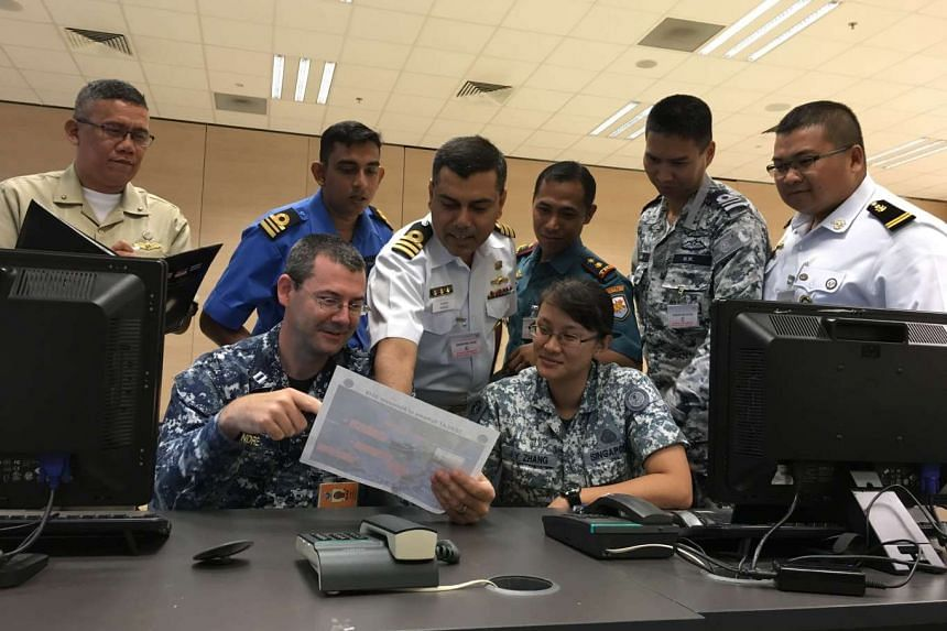 Participants of this year's Seacat exercise at the Multinational Operations and Exercises Centre at the  Changi Command and Control (C2) Centre in Changi Naval Base.