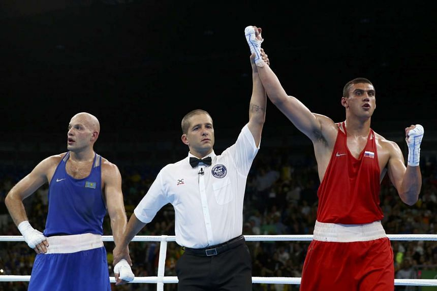 Evgeny Tishchenko of Russia reacts after winning his bout against Vassiliy Levit of Kazakhstan at the Rio 2016 Olympics men's heavyweight boxing final.
