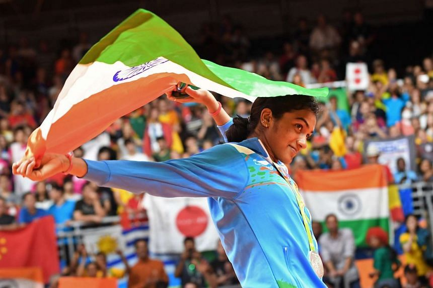 Silver medalist India's Pusarla V. Sindhu celebrates on the podium following the women's singles Gold Medal badminton match at the Riocentro stadium in Rio de Janeiro on Aug 19, 2016.