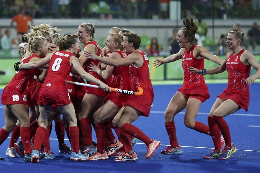 Britain celebrates winning the women's hockey gold medal match against the Netherlands at the Rio 2016 Olympic Games.