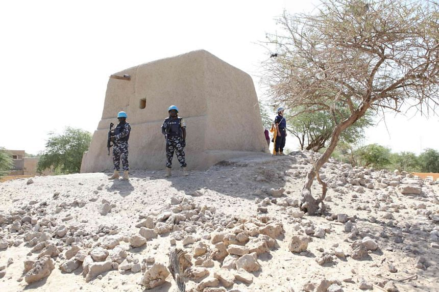 United Nations peacekeepers standing next to the mausoleum of Alpha Moya in Timbuktu on Feb 4, 2016.