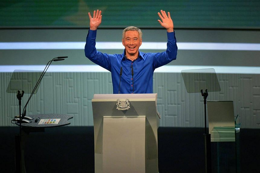 PM Lee Hsien Loong waves to the audience after returning to the stage to finish his speech after an intermission following a near-fainting spell.