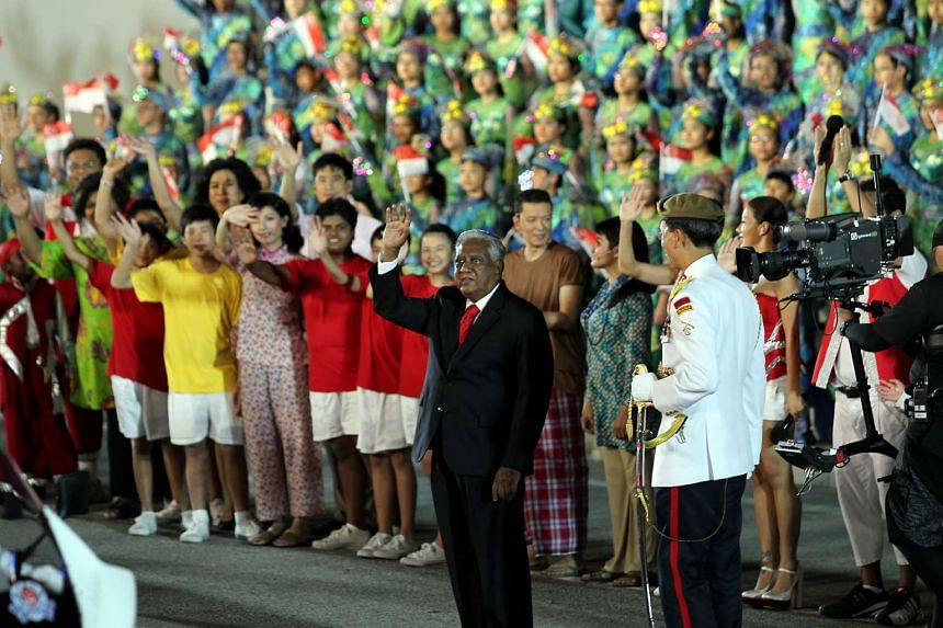 Then President S R Nathan waving to the crowd during the National Day Parade at the Marina Bay Floating Platform on Aug 9, 2011.