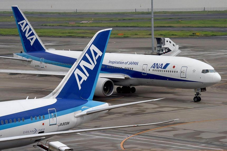 Japanese airline All Nippon Airways planes seen on the tarmac at the Haneda Airport in Tokyo on August 3.