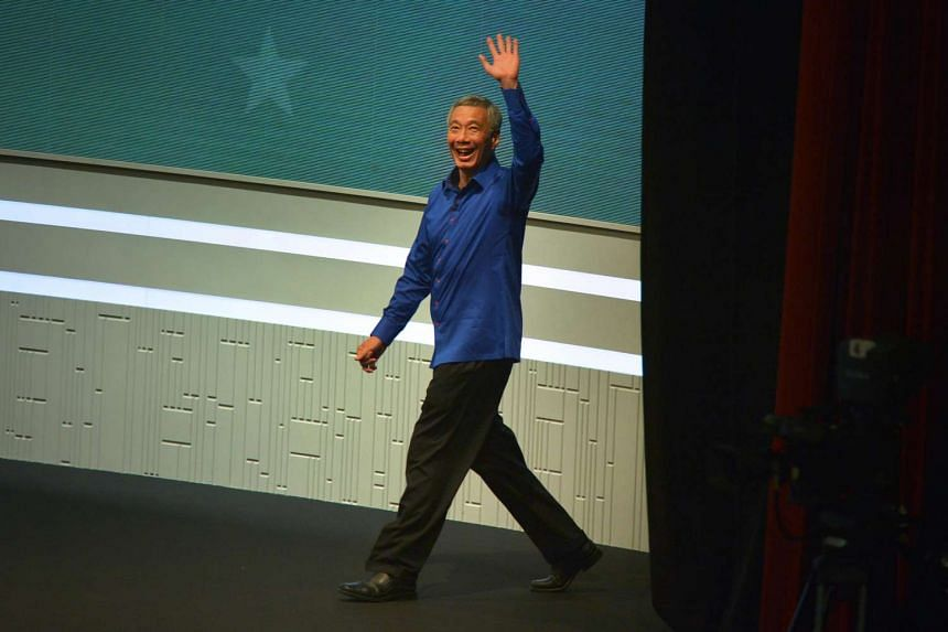 PM Lee Hsien Loong returns to the stage to resume his National Day Rally.