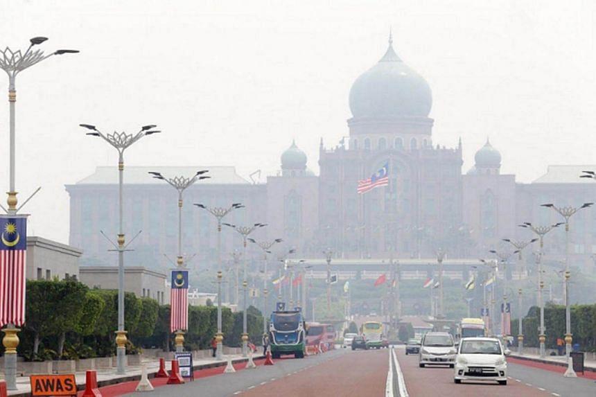 The Perdana Putra building is pictured shrouded in haze in Putrajaya August 16.
