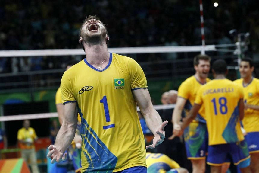 Captain Bruno Mossa Rezende of Brazil and teammates celebrate after winning the men's volleyball final against Italy of the Rio Olympics.