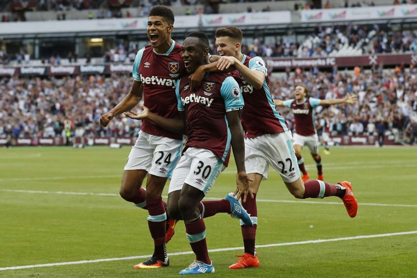 West Ham United's Michail Antonio celebrates scoring their first goal with Ashley Fletcher and Sam Byram.