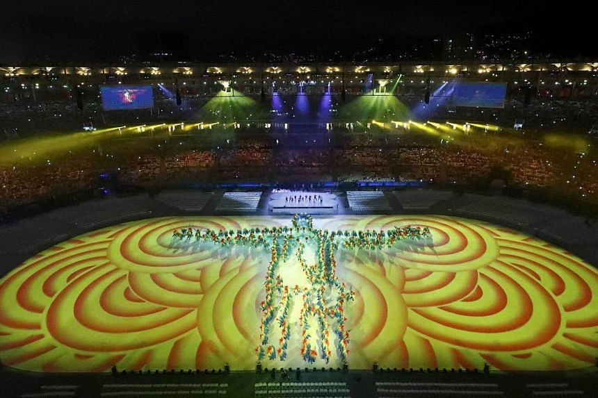Performers form an image of the Christ the Redeemer statue in the Rio Olympics closing ceremony.