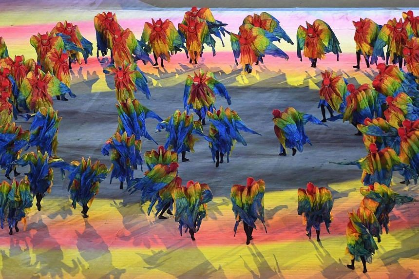 Dancers performing during the closing ceremony in a colourful display.