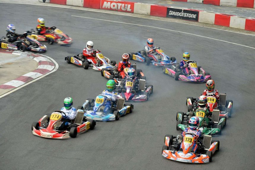Ethan Tan (No. 123) leading the other 11 drivers at the start of yesterday's race at KF1 Karting Circuit in Kranji. He does not see himself aiming for F1 but will decide which class to specialise in once he wins a karting race in Europe.
