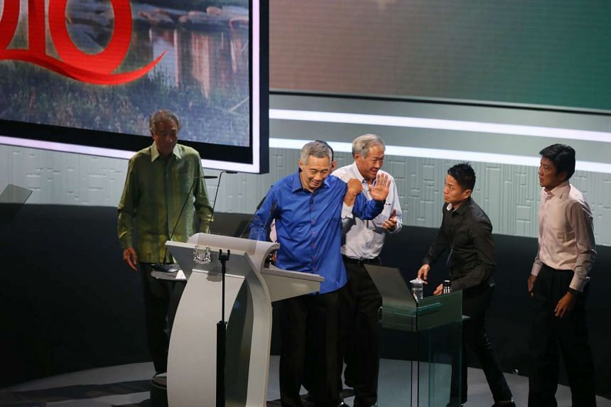 Defence Minister Ng Eng Hen rushes to PM Lee's side after he took ill while delivering the National Day Rally speech yesterday. He is helped by Dr Ng off stage. Behind Dr Ng is Acting Education Minister (Schools) Ng Chee Meng. Mr Lee is also accompan