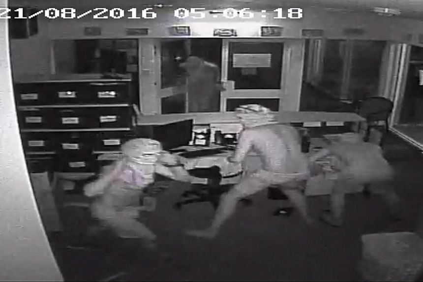 CTV footage showing four unidentified men breaking into Taminmin College, in Humpty Doo, in Australia's Northern Territory.