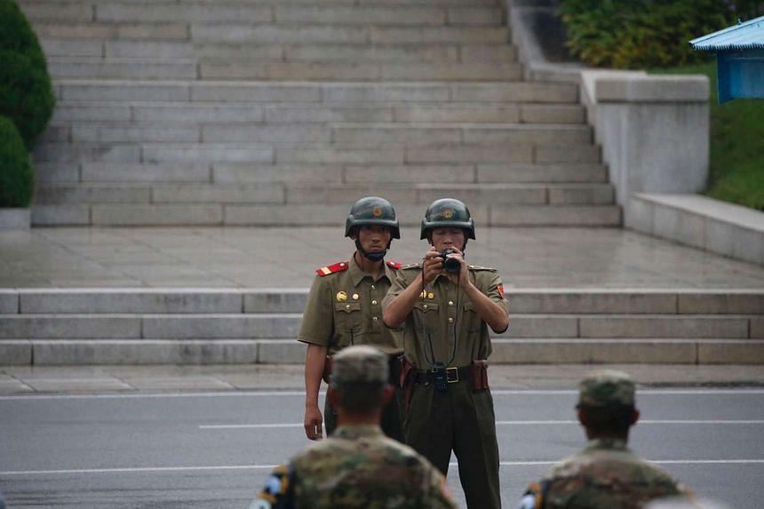 North Korean soldiers keep watch toward the South along the Demilitarized Zone (DMZ) on July 27, 2016.