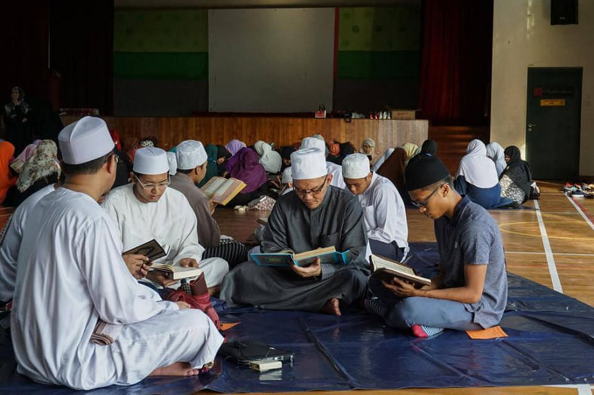 Students at a Pergas programme on June 20. The Islamic teachers' group yesterday welcomed the move to make the registration of Islamic teachers mandatory.