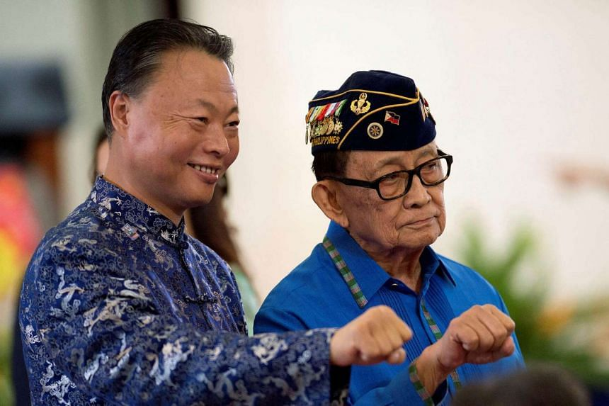 Chinese Ambassador to the Philippines Zhao Jianhua (left) and former Philippine President Fidel Ramos pose for a picture in Quezon city, Philippines.