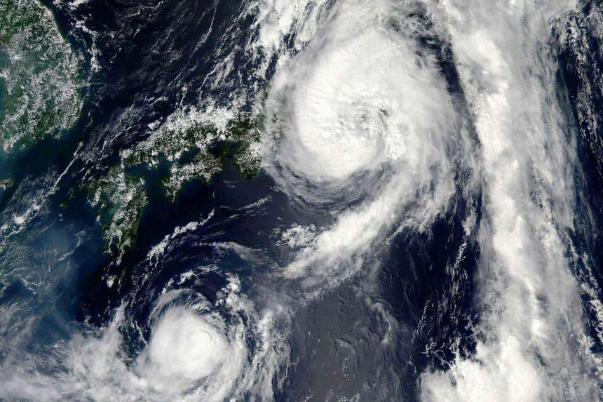 A NASA satellite image shows Typhoon Mindulle over Japan.
