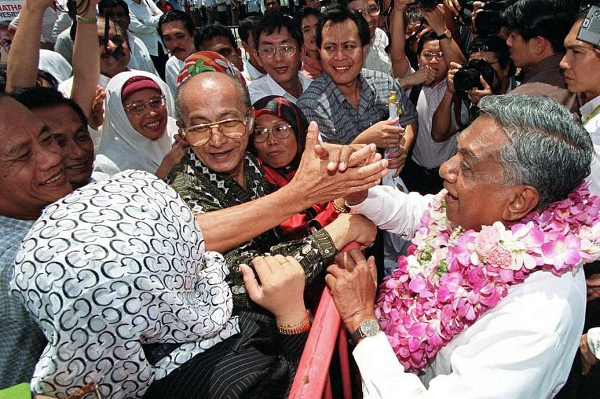 Singapore's then new president S R Nathan greets supporters outside the nomination centre in Singapore in August 1999.