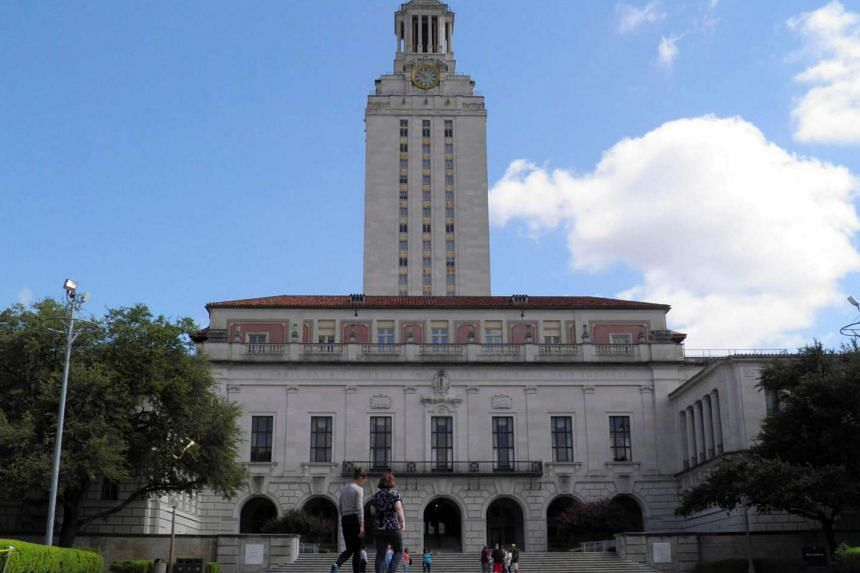 People walk at the University of Texas campus in Austin, Texas, US on June 23.