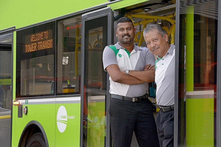 Mr Shanmugam (left), who has 10 years of driving experience, joined Tower Transit as a driver, but has been redeployed to be a trainer. With him is interchange supervisor Abdu Rahi Jusof.