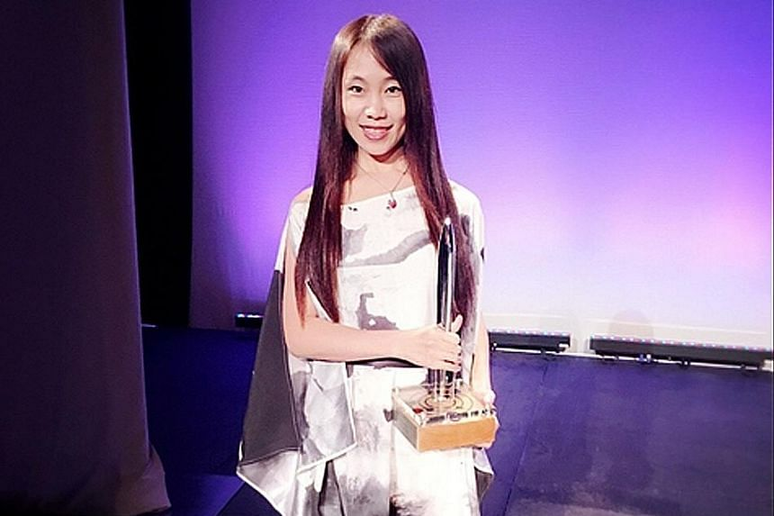 Chinese science-fiction author Hao Jingfang (above) with the Hugo Award for her book, Folding Beijing.