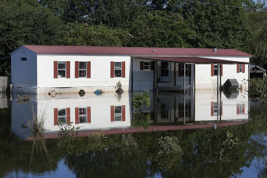 This home in St Amant, Louisiana, in the United States, is one of 40,000 houses damaged by a week of catastrophic floods in the south of the state. So far, 13 people have died and around 30,000 had to be rescued. More than 86,000 have registered for