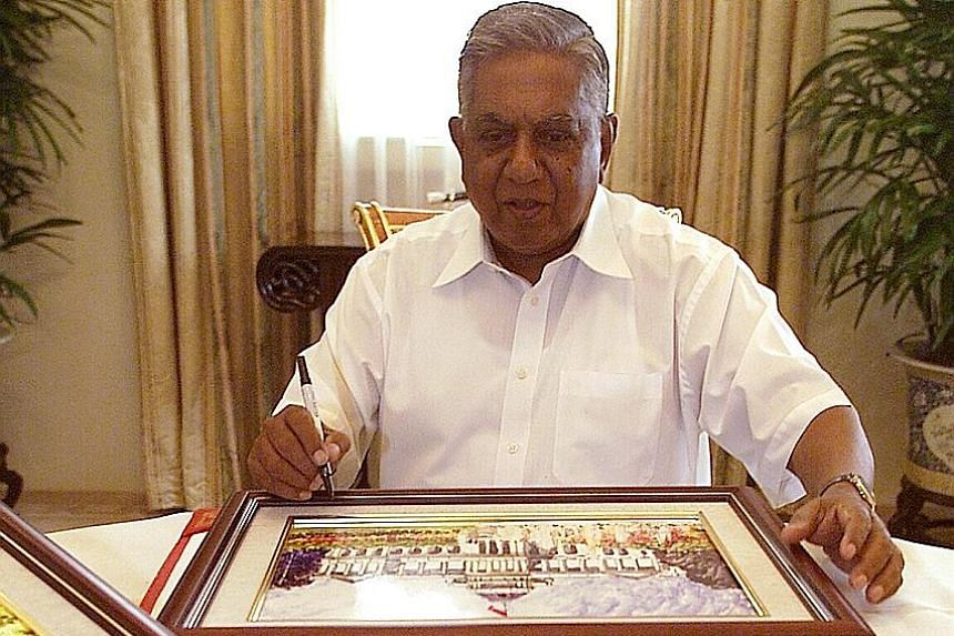 Then President S R Nathan signing his name on tile paintings to raise funds for the President's Challenge in 2003. Mr Nathan, who started his public service career as a seamen's welfare officer in 1956 and rose to become President of Singapore in 199