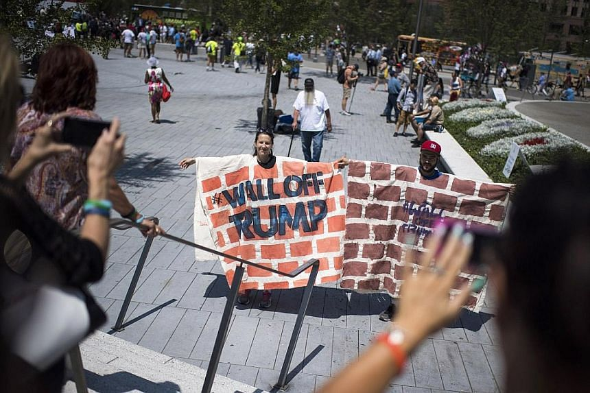 Anti-Trump demonstrators in Cleveland on July 19 reenacting their displeasure with Mr Trump's vow to build a wall on the US-Mexico border to keep Mexican immigrants out.