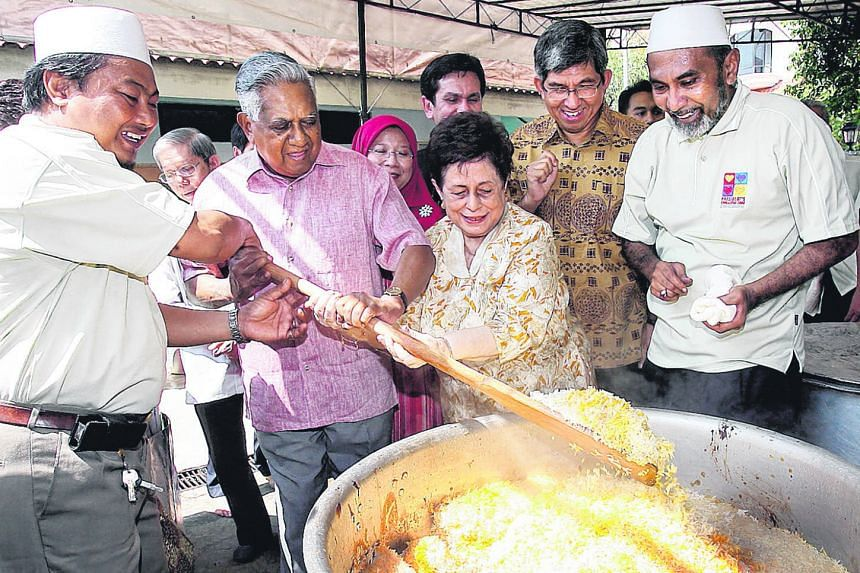 President Nathan and his wife Urmila Nandey stirring briyani rice with the help of a volunteer at a Muis charity event in 2008. The funds raised went to the President's Challenge 2008. Mr Nathan outside his home on Aug 18, 1999, before his nomination