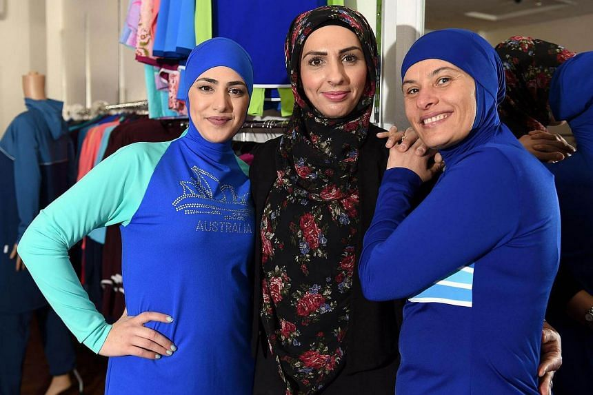 Muslim models display burkini swimsuits at a shop in western Sydney on August 19.
