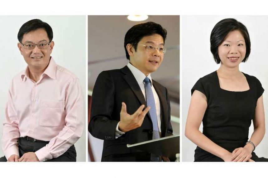 (From left) Finance Minister Heng Swee Keat, Minister for National Development Lawrence Wong and Senior Minister of State Sim Ann.